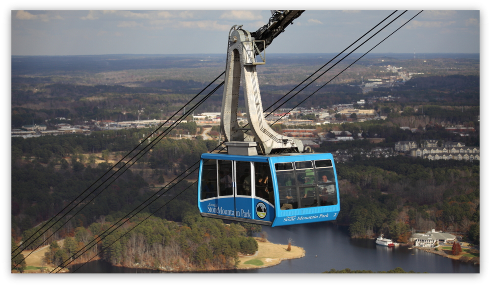 Stone Mountain Park, Dec 03, 2012 - The blue Summit Skyride/Skylift car descends from the top of Stone Mountain